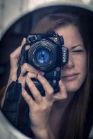 girl looking through camera