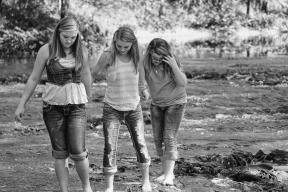 girls in a stream