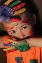 young boy finger paint all over hands